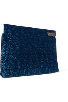 Loewe's cobalt clutch is made from plush velvet that's embossed with the label's signature stamp. Expertly crafted in Spain, this pared-back piece is trimmed with hand-painted edges and has a smooth leather zip fastening. Stow your cell phone and cards inside the pocketed herringbone interior. x