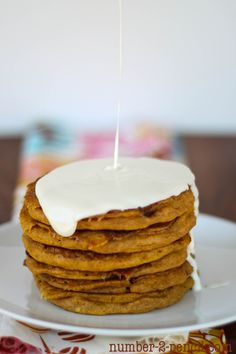 Pumpkin cinnamon roll pancakes on iheartnaptime.net ! These look SO good!  #pumpkin #recipe