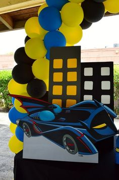 Car and building decorations at a Batman Birthday Party!  See more party ideas at CatchMyParty.com!