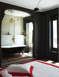 Digging the dark walls and mouldings. Gives the architecture a silhouette feel, and seems so elegant!