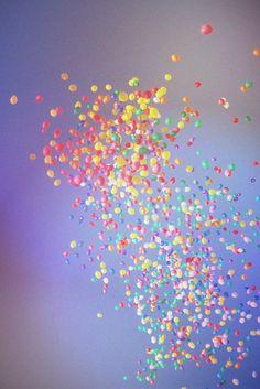 balloons splattered across the sky