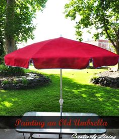 """Painting your Old Umbrella - turn a faded outdoor umbrella into a """"new"""" umbrella with spray paint & ribbon trim.  Click on image for instructions."""