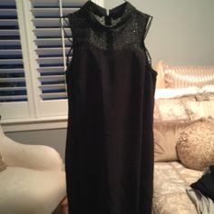LOFT Black Sleeveless Dress Sleeveless collar dress with a little of black/goldish sparkle above the waist.  Black.  Size 10.  Excellent condition. LOFT Dresses
