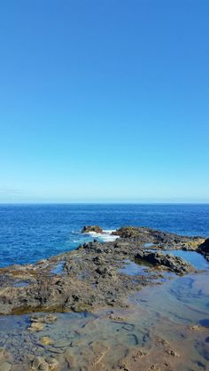A rocky shore looks beautiful along this Hawaii coastline with the blue sky and Pacific Ocean water. Hawaii Travel Guide, Maui Travel, Nightlife Travel, Travel Tips, Travel Packing, Trip To Maui, Hawaii Vacation, Vacation Ideas, Maui Hawaii