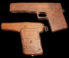 1930s carved wooden toy pistols.