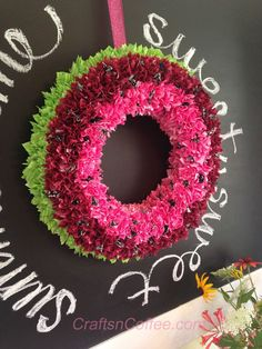 A sweet, colorful and easy summertime Watermelon Wreath made with fabric and a wreath of Styrofoam brand foam. Tutorial on CraftsnCoffee.com