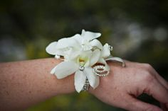 White orchid and rhinestone wrist corsage In Bloom Florist, Prom Flowers, Wrist Corsage, White Orchids, Wedding Rings, Engagement Rings, Jewelry, Enagement Rings, Jewlery