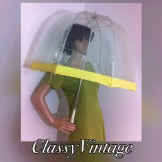 Fab 60's /70's clear vinyl umbrella. Sold Dome style clear vinyl . Metal trim - yellow lucite handle - wrist strap - and snap strap to keep it together. This item may not be bundled as it travels in a special box for umbrellas. Fun fab vintage!!! Vintage Accessories Umbrellas