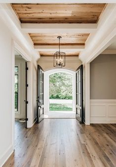 I really like the exposed wood on the ceiling and the open feel right when you walk through the door.