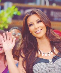 KIM K, she looks like a princess in a parade with the overly fake wave.