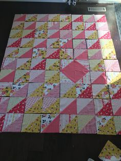 Here is a neat 8 inch triangle half square triangle quilt with many options.