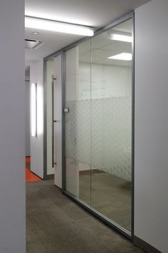 Acme 50 seamless glass walls installed at a NYC media company.