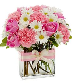 white daisies, pink roses and pink carnations