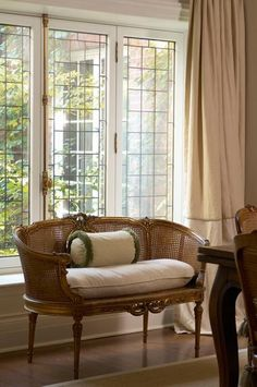 Love the windows and settee...