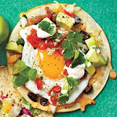 Huevos Rancheros Tacos - nice brunch idea! Can reduce or remove oil if you have a nonstick pan and I'd sub a small amount of low fat sour creme for the crema
