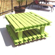 Outdoor coffee table made with old pallets, 4x4's and some casters! One Sunday to build and one Saturday to paint! Got the idea from another pin on pinterest.