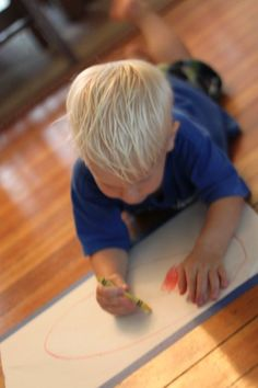 Set the kids up to draw on the floor