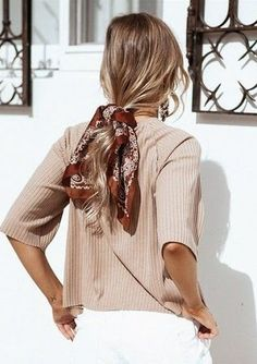 Love the scarf and low ponytail.