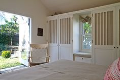 """Ok, I probably won't be ending up living in a place where you can sleep with the doors wide open, but it is a lovely idea. And I love the """"barn stall"""" style of the closet doors with linen inserts!"""