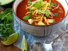 Tortilla Soup | From south of the border comes this spicy and hearty soup ladled over crisp tortilla strips and grated cheddar. The soup is chunky with chicken and av...