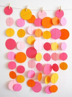 "Simple & cute backdrop garland! 2"" & 1 1/2"" scrapbook paper circles sewed together with a sewing machine"