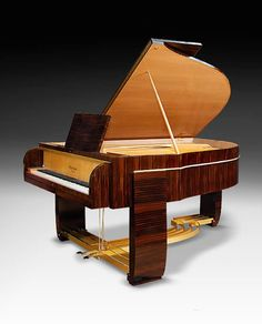 An extraordinary Art Deco Gaveau Grand Piano with casework by René Prou and Albert Guénot
