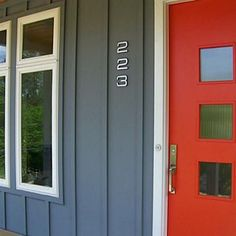 "Sherwin Williams ""Daredevil Orange"" front door paint colour."