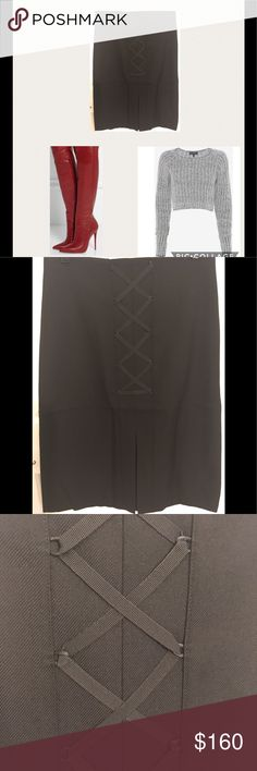 Etienne Aigner Wool Skirt-NWT 100% wool designer midi skirt with split and lace up design in front. Skirt is fully lined with zipper back. Approximately 28 inches. NWT Size 4 Etienne Aigner Skirts Midi