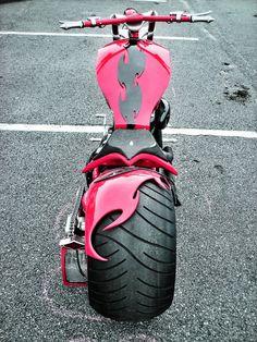 bright red, custom built Harley chopper motorcycle...