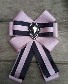 Check out this item in my Etsy shop https://www.etsy.com/listing/556788042/beautiful-new-trend-ribbon-brooch-woman