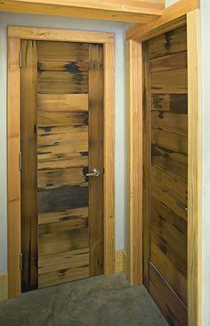 Reclaimed vat stock wood celebrates original patina on interior doors. Doors, Custom Door, Exterior Doors, Interior And Exterior, Custom Homes, Tall Cabinet Storage, Interior, Remodel, Doors Interior