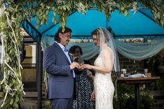 Outdoor Jewish ceremony with greenery on the chuppah found on Modern Jewish Wedding Blog. Photo by Steve Koo.
