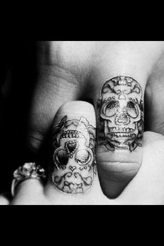 Matching figure tattoos