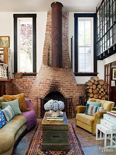 A brick fireplace with a steamship-pipe chimney makes this sunken living room a comfortable place to curl up after a day on the lake. An antique travel trunk stands in as a distinctive coffee table, while vibrant velvet upholstery adds soft texture.