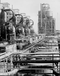 "Crude-oil pipe stills, rundown tanks, and ""Cat Crackers"" at the Baton Rouge Esso Refinery, ca. 1945. Photograph by Edwin Rosskam."