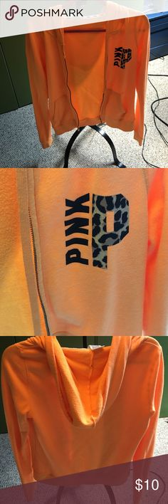Victoria Secret Pink hoodie Bright orange zip up hoodie with a cheetah print P on the front. PINK Victoria's Secret Tops Sweatshirts & Hoodies