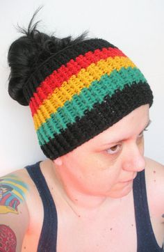 Super cute and fashionable crochet extra wide ear warmer headband, hand crafted from premium acrylic and wool blend yarns in red, gold, green, and black.