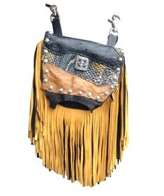 "MARIGOLD MARTY - super soft, made of black deerskin with a 7"" black and gold deerskin fringe. The flap has a striking swatch of printed leather and genuine ostrich. The silver filigreed centerpiece has an aquamarine colored jewel inside. Etched silver metal studs outline the flap. Wear bag clipped to belt loops for hands-free carrying of your essentials. Interior includes a leather strap. Add the strap when you want a completely different look."