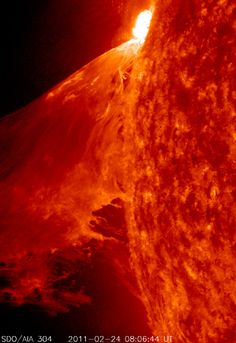 "Credit: NASA/SDO NASA's Solar Dynamics Observatory captured this view of a powerful Class solar flare on Feb. 2011 during a sun storm. NASA scientists called the display a ""monster prominence"" that kicked up a huge plasma wave."
