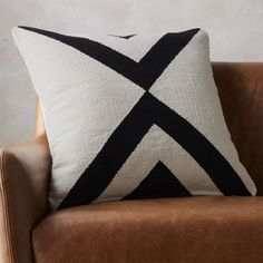 """Shop 23"""" xbase pillow.   Handmade dhurrie pattern crisscrosses in contrasting ivory and black.  100% cotton flips to solid natural."""