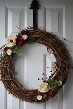 Seasonal Holiday Wreath for Christmas or Year Round. $26.00, via Etsy. grapevine wreath with felt rolled roses in red, green and white...lovely!!
