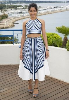Sporting nautical stripes, Freida Pinto looked radiant in a Salvatore Ferragamo cropped halter top and matching full skirt.
