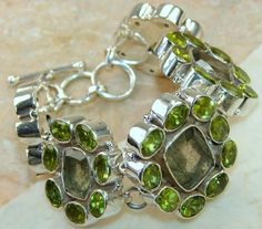 Rutilated Quartz, Peridot Faceted bracelet designed and created by Sizzling Silver. Please visit  www.sizzlingsilver.com. Product code: BR-7849