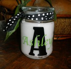 I may have to pinch this idea! Personalized Candle vinyl by belleoftheballdesign on Etsy, $13.50