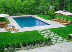 CLC Landscape Design created a visually attractive landscape setting around the formal design of this Tenafly pool, which has a retractable cover.