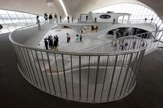 From Kathryn Yu, marvelous shots inside the famous and now-shuttered TWA terminal designed by Eero Saarinen.