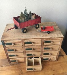 Vintage red wagons and a wonderful multi-drawer box
