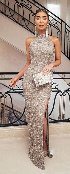 #spring #outfits woman wearing silver glitter sleeveless slit dress carrying purse. Pic by @fashionative