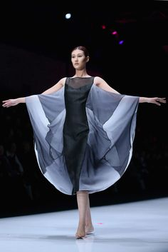 A model showcases designs on the catwalk during China Fashion Designer Top Award Winners Collection of China Fashion Week S/S Collection 2013 on October 31, 2012 in Beijing, China.