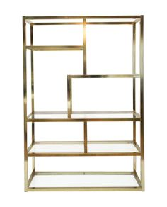 A spectacular large scale etagere featuring a brilliant, brass plated   finish and six glass shelves.